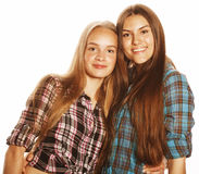 Two cute teenagers having fun together  on white Stock Photos