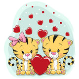 Two Cute Tigers with hearts. On a blue background vector illustration
