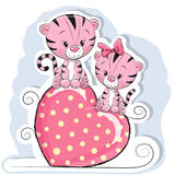 Two Cute Tigers is sitting on a heart Royalty Free Stock Photos