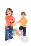 Two cute toddler girls with balloons Royalty Free Stock Photo