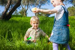 Two cute toddlers busy with Easter Hunt Royalty Free Stock Photos