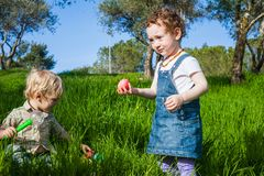 Two cute toddlers at Easter Hunt Royalty Free Stock Photos