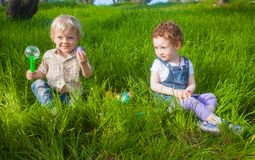 Two cute toddlers found eggs Stock Photography