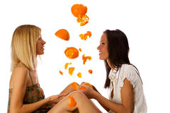 Two cute twins girls having fun under orange rain Stock Photography