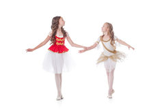 Two cute young ballerinas looking at each other Stock Photo
