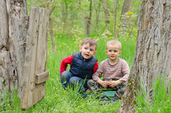 Two cute young boys playing in woodland Stock Photos