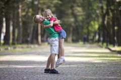 Two cute young funny smiling children, girl and boy, brother hol stock photography