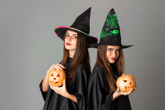 Two cute young girls in halloween style Stock Images