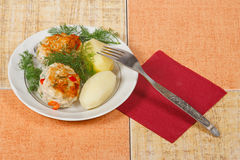 The two cutlets with potato and greens. The two appetite cutlets with potato and greens Royalty Free Stock Image