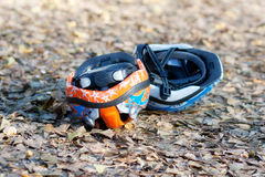 Two cycling helmets upside-down on the ground Stock Photo