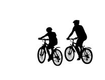 Two cyclist. Silhouette isolated over white background Stock Photos