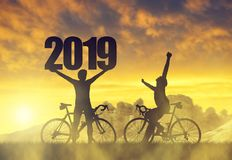 Two cyclist with bicycle at sunset. Forward to the New Year 2019 stock photo