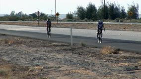 Two cyclist compete on RAAM stock footage
