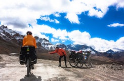 Two cyclist on mountains road. Himalayas, Jammu Stock Photo