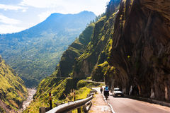 Two cyclist riding on hi-mountain road. Manali-Leh road in Indian Himalayas, Jammu and Kashmir State, North India Stock Image