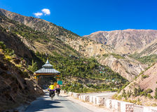 Two cyclist riding on mountains road. Himalayas, Jammu and Kashmir State, North India. Himalayas landscape, two cyclist, tibet gates Stock Photo
