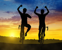 Two cyclist riding a road bike Stock Images