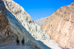 Two cyclist standing on mountains road. Himalayas. Picture taken during bicycling trip in autumn. Himalayas, India Royalty Free Stock Image