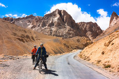 Two cyclist standing on mountains road. Himalayas Royalty Free Stock Images