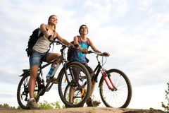 Two cyclists Stock Images