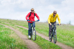 Two cyclists. Relax biking outdoors royalty free stock image