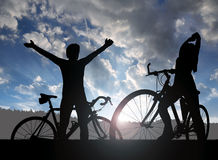 Two cyclists on a bicycle Stock Photography
