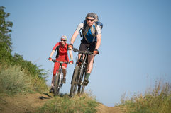 Two cyclists biking. Two cyclists relax biking outdoors royalty free stock image