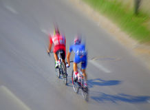 Two cyclists blurred motion Royalty Free Stock Photo