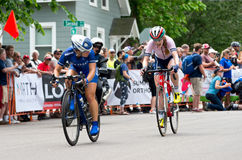 Two Cyclists Chase Leaders. Stillwater, Minnesota, USA - JUNE 18, 2017: Two pro cyclists chase leaders at the 2017 North Star Grand Prix Women's Stillwater Stock Image