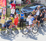 Two Cyclists on Col du Glandon - Tour de France 2015 Royalty Free Stock Photos