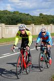 Two cyclists crossing Blithbury reservoir, UK. Royalty Free Stock Photo