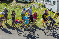 Two Cyclists on Grand Colombier - Tour de France 2016 Stock Photos