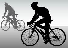 Two cyclists in motion Stock Image