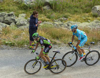 Two Cyclists on the Mountains Roads -Tour de France 2015 Stock Images