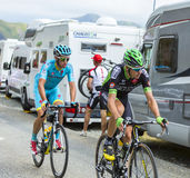 Two Cyclists on the Mountains Roads -Tour de France 2015 Royalty Free Stock Photos