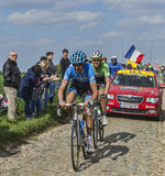 Two Cyclists- Paris Roubaix 2014. Carrefour de l'Arbre,France-April 13,2014: Two cyclists (Johan Vansummeren -Garmin Sharp and Maarten Tjallingii-Belkin) riding Royalty Free Stock Image