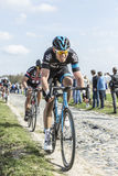 Two Cyclists - Paris Roubaix 2015. Carrefour de l'Arbre,France - April 12,2015: The Welsh cyclist Luke Rowe of Team Sky, followed by the German cyclist John Royalty Free Stock Photography