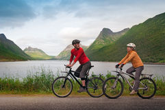 Two cyclists relax biking Royalty Free Stock Image