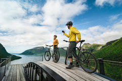 Two cyclists relax biking. Outdoors royalty free stock photography