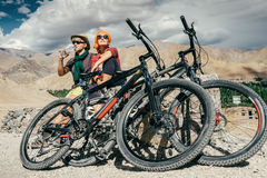 Two cyclists rest on the mountain road Stock Photo