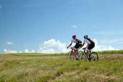 Two Cyclists ride on road in south France Royalty Free Stock Photo