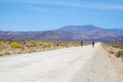Two cyclists riding on a dirt road in the Karoo Stock Images