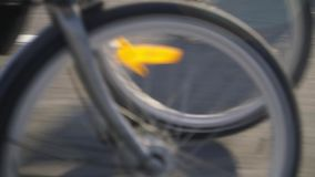 Two cyclists riding on the track,. The camera, taking a close - up of the wheel sees off the movement of cyclists stock footage