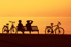 Two cyclists in silhouette Royalty Free Stock Photos