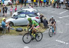 Two Cyclists - Tour de France 2015. Col du Glandon, France - July 24, 2015: Two cyclists Peter Sagan of Tinkoff-Saxo and Jan Bakelants of AG2R La Mondiale Royalty Free Stock Image