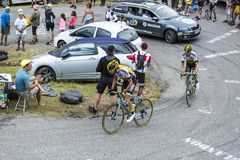 Two Cyclists - Tour de France 2015. Col du Glandon, France - July 24, 2015: Two Dutch cyclists, Laurens ten Dam and Bram Tankink of Team LottoNL-Jumbo,climbing Royalty Free Stock Images