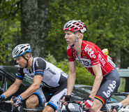 Two Cyclists - Tour de France 2014. Le Markstein, France- July 13, 2014:The cyclists Marcel Sieberg of Lotto-Belisol and Tom Veelers of Giant-Shimano Team Royalty Free Stock Image