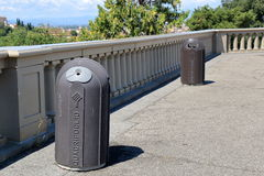 Two cylindrical trash containers in Florence, Italy Royalty Free Stock Photography