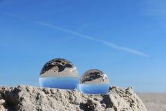 Crystal balls at the beach royalty free stock image