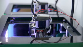 Two 3D printers creating objects. stock video footage